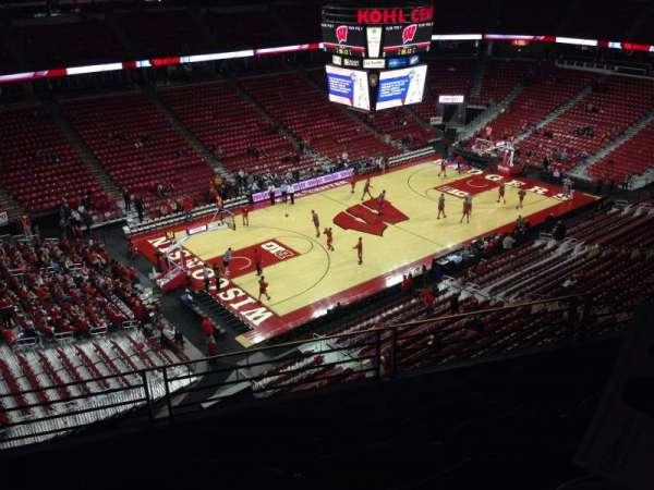 Kohl Center, vak: 311, rij: D, stoel: 6