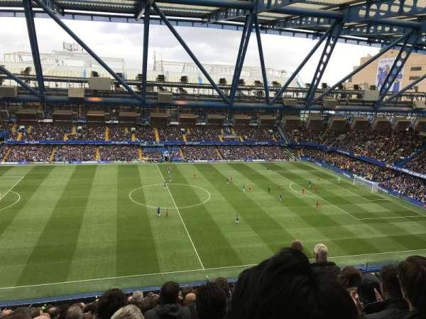 Stamford Bridge, vak: West Stand Upper - Block 5, rij: 17, stoel: 134