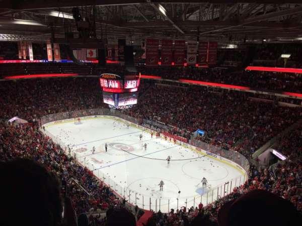 PNC Arena, vak: 318, rij: F, stoel: 9